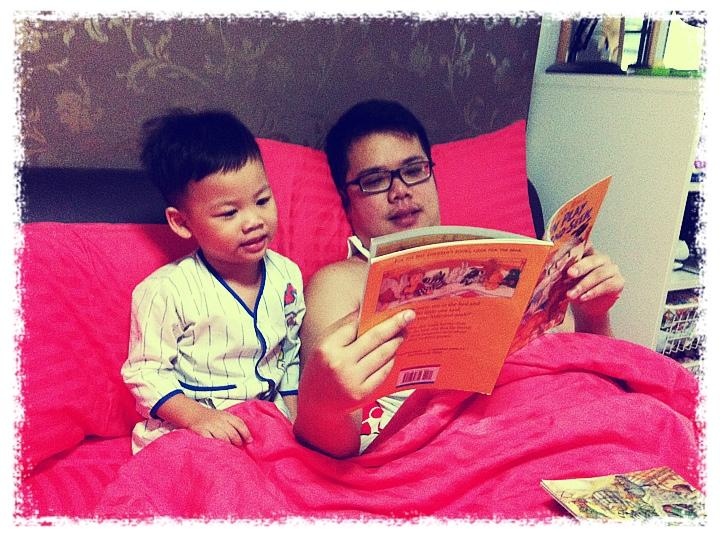 Daddy Reading to Boy