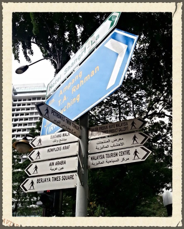 The road sign near Shangri-La KL stating the directions and distance to the landmarks.