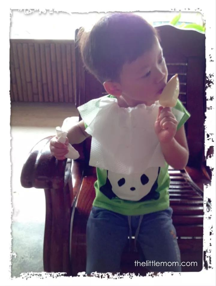 Look at how the boy is savouring on his goat milk ice-cream.
