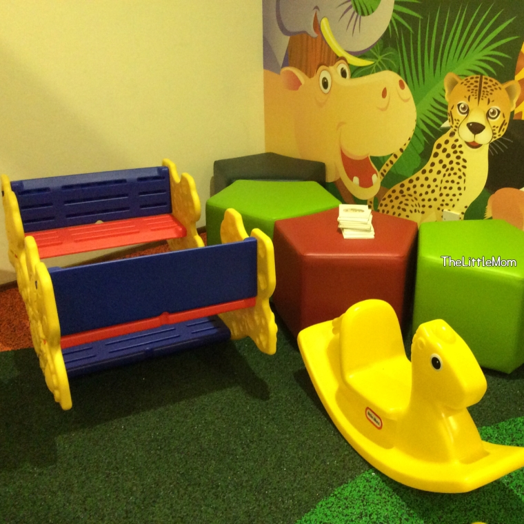 "Rockers and ""see-saw"" for the little ones and colorful stools for the parents."
