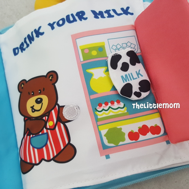 """The milk can actually be """"taken"""" from the fridge and put onto Mummy Bear's hand."""