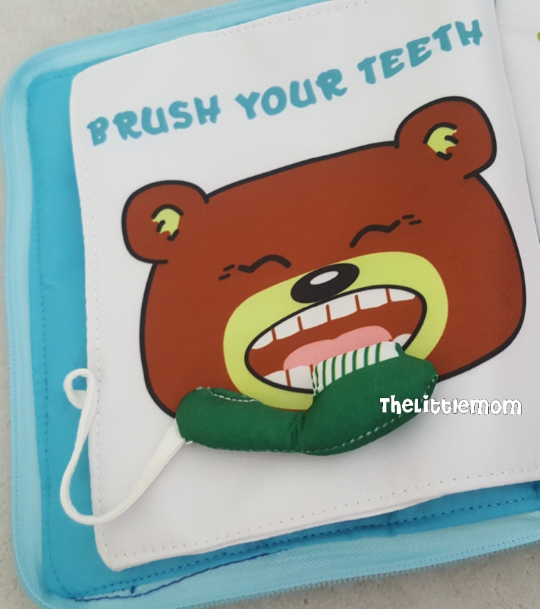 """The toothbrush is """"loose"""" so the kids can actually brush the Baby Bear's teeth with it."""