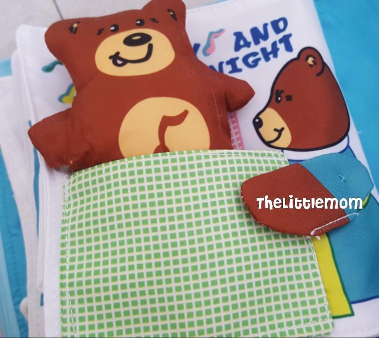 Mummy Bear tucking Baby Bear to bed.